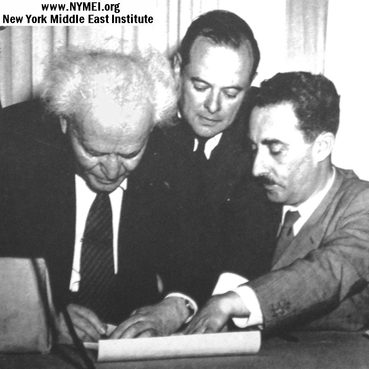 Ben Gurion is signing a small piece of scroll